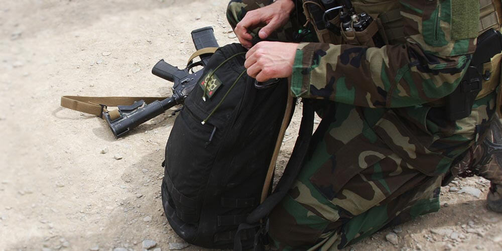 army special forces soldier using rucksack