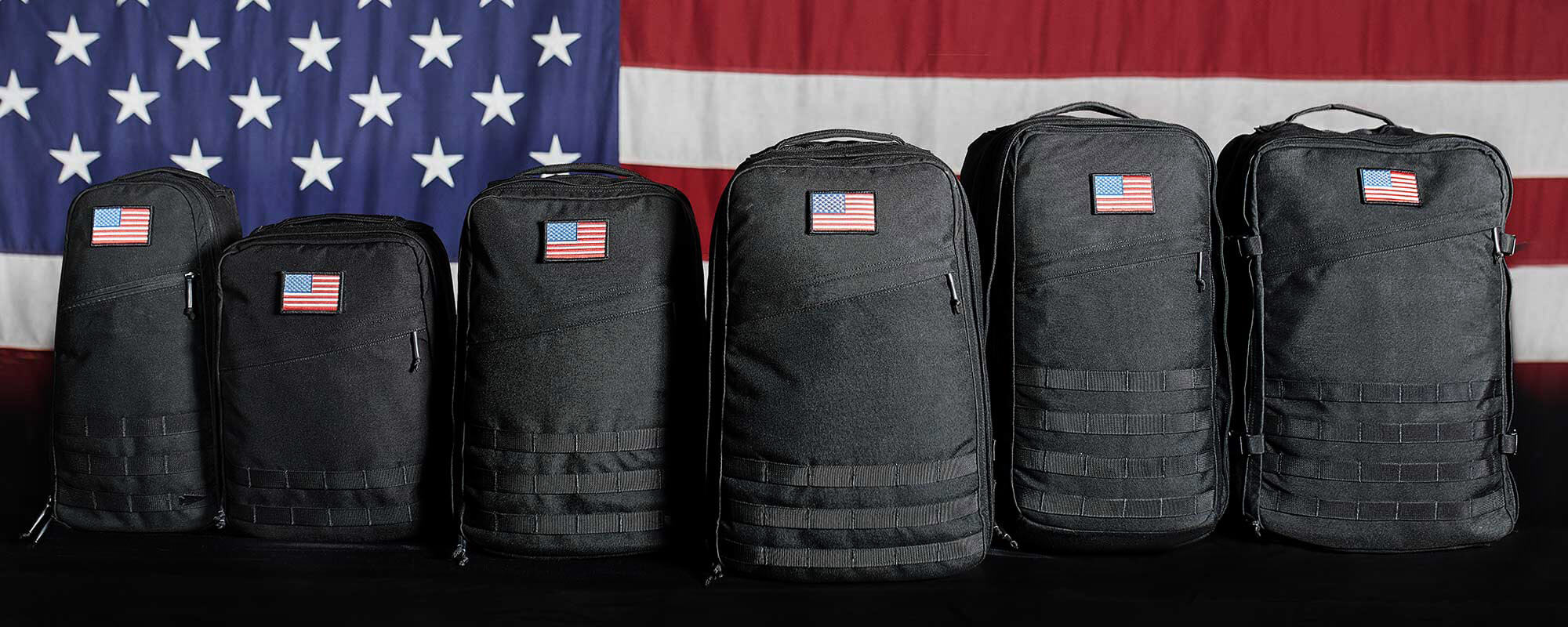 rucksacks in front of american flag